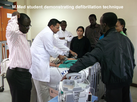 M.Med student demonstrating defibrillation technique